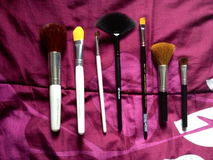 Elf total face brush, Elf foundation brush, Elf defining eye brush, Elf fan brush, Loew- Cornell 7400 angular 3/8 (great for angled brush for doing eyeliner or filling in brows), blush brush and eyeshadow brush from a makeup set