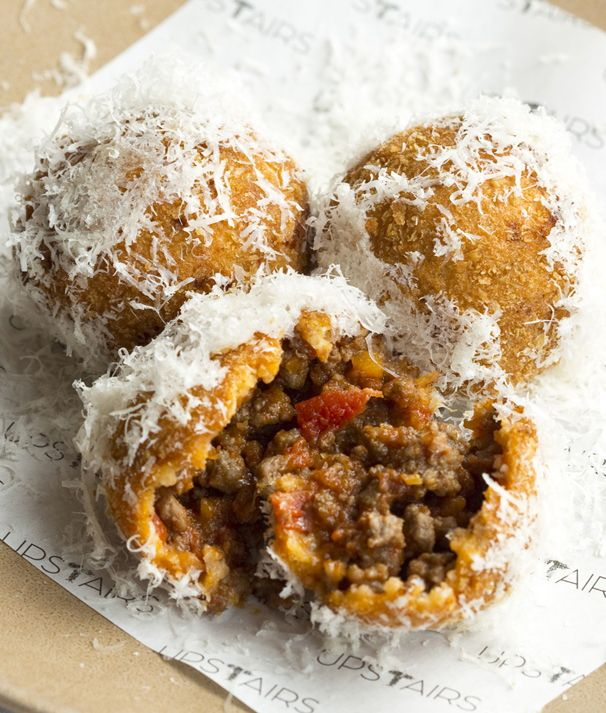 A delicious canapé or snack, these bite-sized bolognese fritters from chef Adam Byatt use venison mince for a rich, gamey flavour. The bolognese mixture can be made ahead and shaped and fried on the day before being coated in a fluffy Parmesan covering.