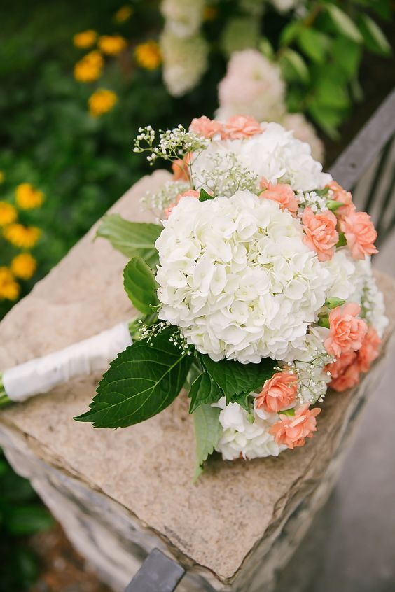 2. White hydrangea wedding Bouquet with Peach Carnation
