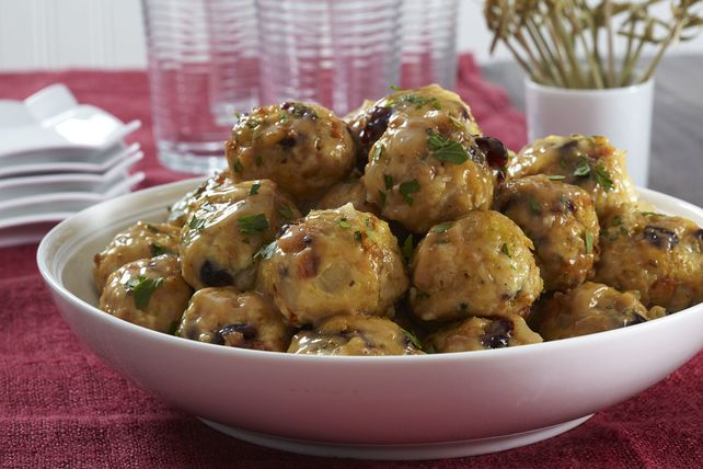 Get the most out of Thanksgiving dinner with these Leftover Turkey and Stuffing Balls! These turkey and stuffing balls get a warm bath in turkey gravy.