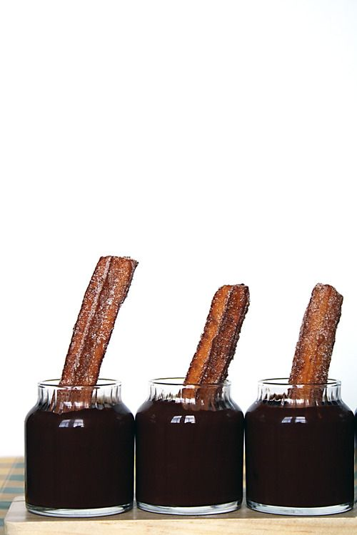 Churros with jars of chocolate dipping sauce