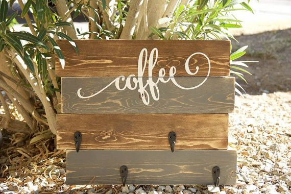 This rustic, distressed coffee mug holder sign features a varied stain background with white script lettering and black hooks. If you would prefer a different color combination, please inform us at th