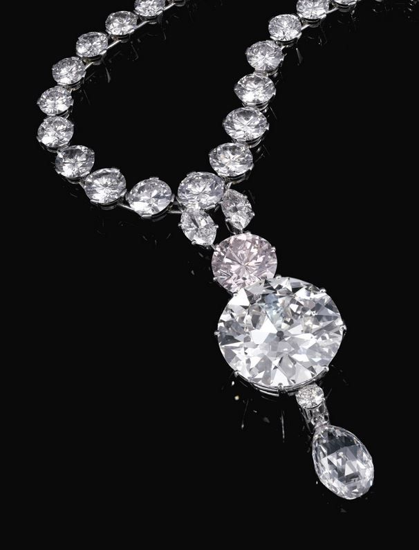 LIGHT PINK DIAMOND NECKLACE Est. 1,410,000 – 2,350,000 CHF. Suspends a detachable pendant set with two marquise diamonds, a brilliant-cut light pink diamond weighing 6.93 carats, two circular-cut diamonds, one weighing 34.78 carats, and a briolette diamond weighing 11.38 carats, from a graduated circular-cut diamond rivière with a step-cut diamond clasp, length approximately 555mm. Accompanied by GIA report no. 5151265278.