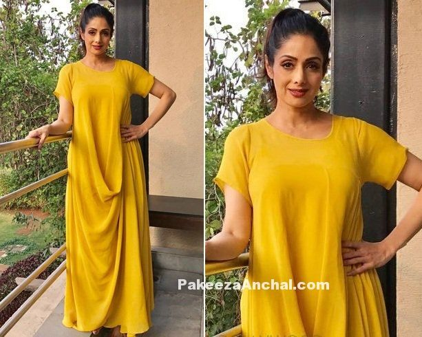 Yesteryear Actress Sridevi looked stunning in a plain yellow colored lose Maxi designed by Stepany. She was styled by Eshaa Amiin in a Dark red lips and hair tied in a ponytail. The bright yellow dress matched with her skin coloring the morning and she looked young and gorgeous than ever.