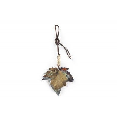 A Maple Leaf - A picturesque leaf of irregular, fantastic shape. One, unique piece which hangs from a leather strap decorated with a ceramic bead. Both elements are hand made – thin ceramics, glossy on both sides, glaze fired twice. Goes really well with sweaters, cardigans and other garments.