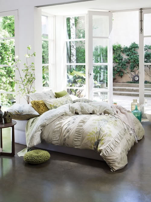 Neutral green conservatory bedroom