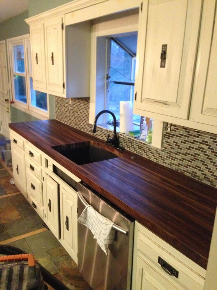 Doing this 100%!! DIY black walnut butcher block counter tops. (DIY Butcher Block counter top, repaint cabinet, tile back splash, paint appliances... see previous pin).