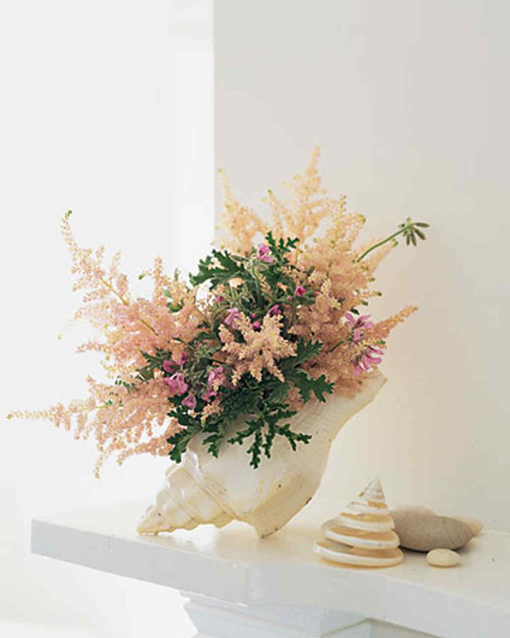 Flower Arrangement In A Seashell Floral Foam And Floral