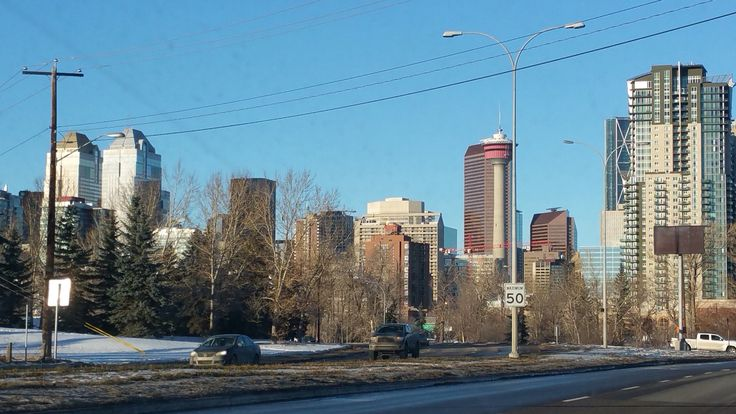 View of Downtown Calgary driving by the Stampede grounds northbound on MacLeod Trail.