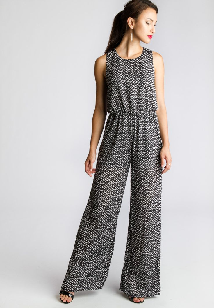 With lightweight fabric and subtle tribal prints make this jumpsuit a stylish and comfortable to wear. Elastic waist line creates a form fitted silhouette. Wide leg pants. Backing details - Back invis
