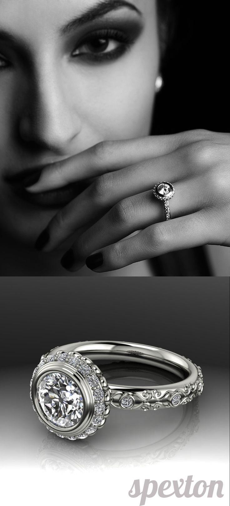 Vintage diamond halo bezel engagement ring by Spexton.