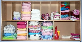 Wall-mounted cloth diapering storage -wipes and spray too.  Into the funny nook in the nursery closet.