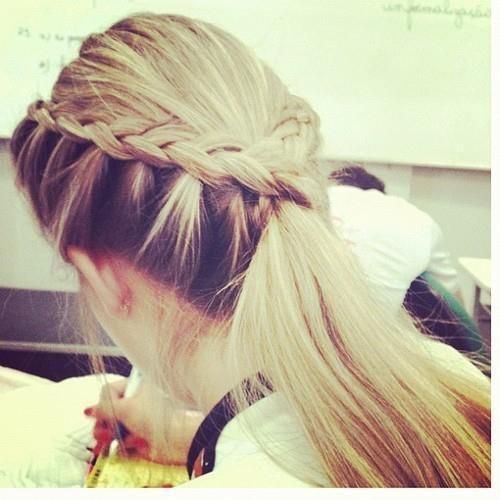 Love the way her braid runs along the side of her crown into a long ponytail