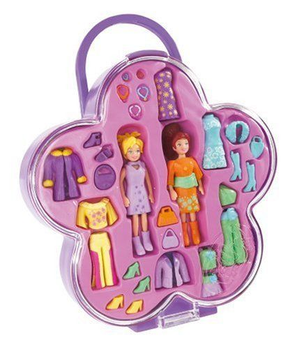 """Polly Pocket Fab Flower by Mattel. $58.95. From the Manufacturer                This Fab Flower® compact is the coolest way to carry a whole line of fashions and accessories for Polly and Lila®. The dolls can get all dressed up in their fancy fashions and jewelry that includes bracelets and necklaces. Whatever clothes they are not wearing, they can put in their """"puzzle"""" pink blister or inside the cool hard flower case to take on-the-go.                              ..."""