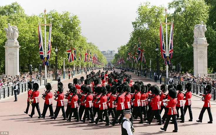 Crowds gathered on The Mall to watch soldiers march from Buckingham Palace as part of the pageantry which is a key feature of the State Opening Of Parliament