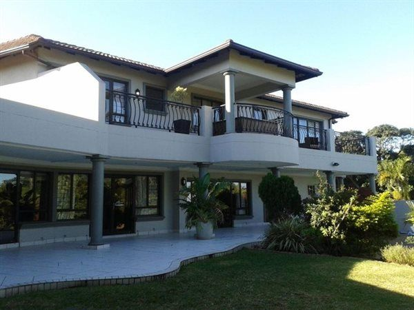 6 Bedroom House in Umhlanga Rocks, Situated on prestigious Ridge Road in Umhlanga, this contemporary double storey family home oozes elegance and style. Brilliant indoor and outdoor living, with easy flow to the covered entertainment a...