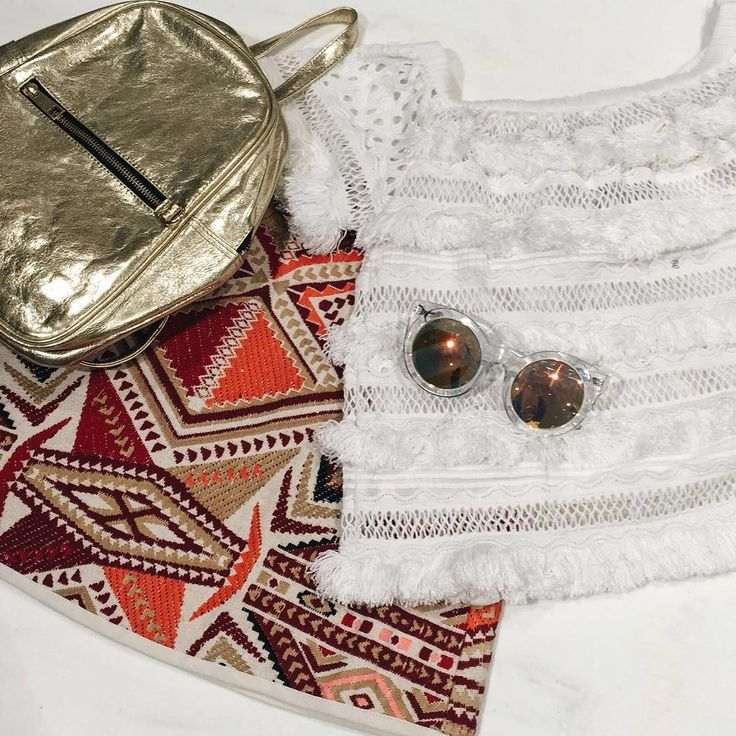 Our holiday packing tips? It's all about mixing up your textures, think crochet bardot tops meet woven prints. #Topshop