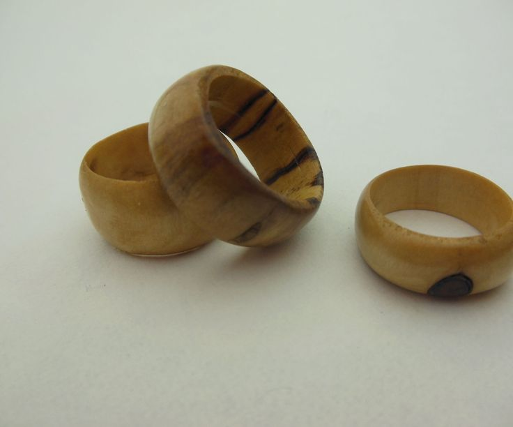 I have always liked rings but they never fit me right and they seem cost to much. So I decided to make my own ring. I had some beautiful scrap wood lying around and I thought that it would look amazing as a ring. I made two rings then thought 'Hey this would be a cool instructable'. The rings fit me perfectly and were free except for the tung oil and the sealer. This is how I made them.You will need:-A Rotary Tool or Large Drill Bit-Sandpaper-Steel Wool-Tun Oil-Lacquer-A Saw