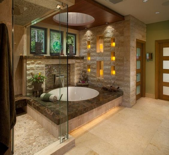 Designed by J. P. Walters, this Asian style contemporary bathroom impressed us since the beginning. Now we believe in love at first sight! The Buddha statue and the LED candles turn this bathroom into a sacred temple of peace and relaxation.: