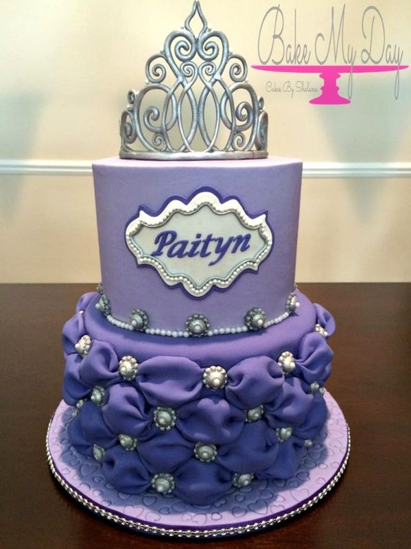 Sofia the First inspired princess birthday cake with handmade gum paste tiara, billowed fondant on bottom tier and sugar brooch accents with name plaque and pearls.