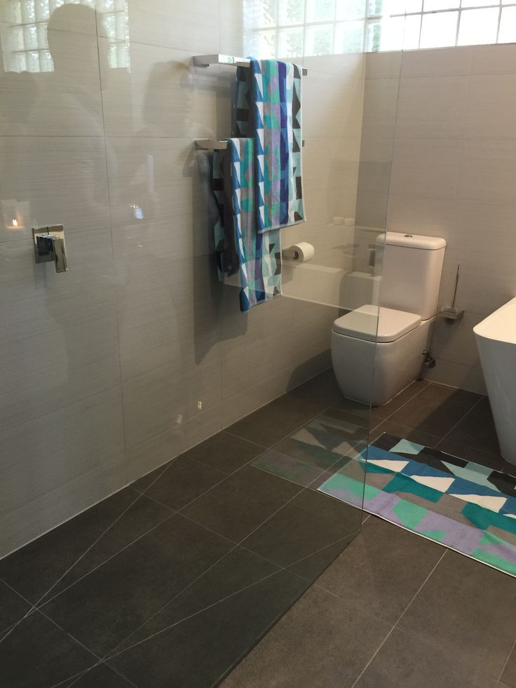 This full bathroom renovation transformed the room into a modern masterpiece. Great interior design with all the latest bathroom products from Highgrove Bathrooms. Frameless Shower Panels with Back to Wall Toilet Suite and Freestanding Bath. Beautiful bathroom accessories