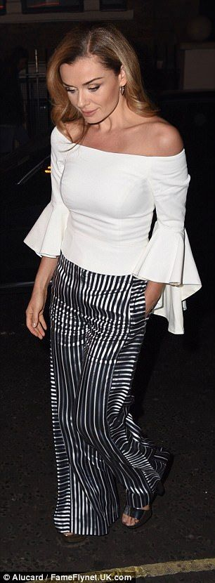 Katherine Jenkins shows off her svelte figure for date night