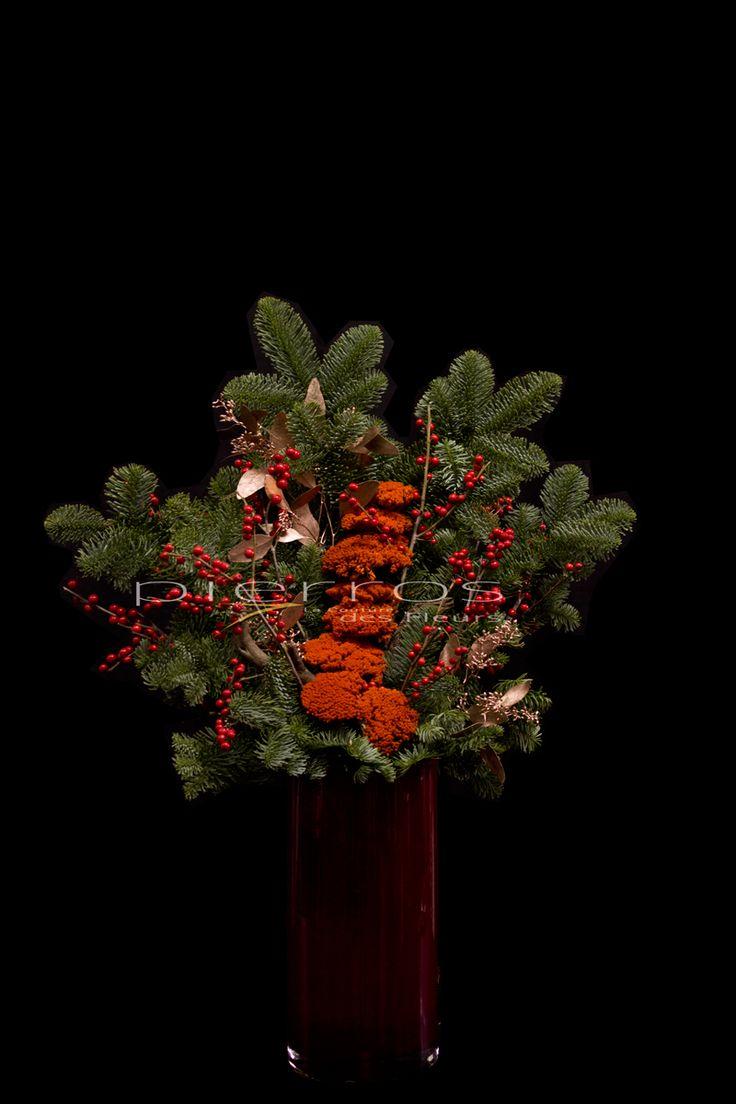"""""""Welcome Christmas"""" bar arrangement by Pierros La Couture Des Fleurs."""