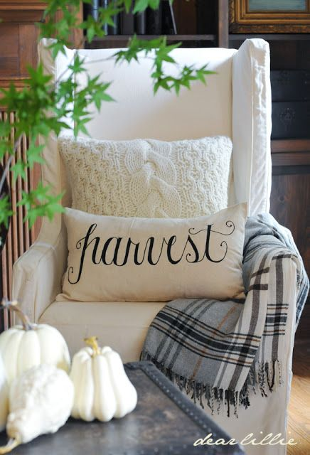 Autumn decor: sweater pillow, IKEA plaid blanket, Dear Lillie harvest pillow cover.   {Dear Lillie}: