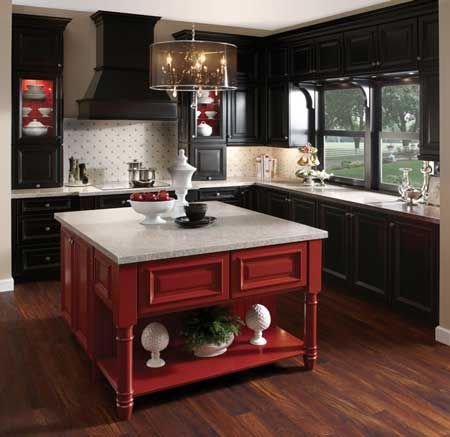 A Kitchen With Black Cabinets And A Red Island Are You