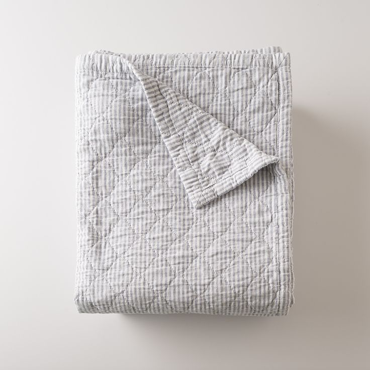 Inspired by classic utility fabric, our blue oxford Diamond Ticking Quilt is made from yarn-dyed cotton for vibrant color and an heirloom look that lasts, wash after wash. Industrial stripes, similar to mattress ticking or an engineer's uniform, make it easy to layer this piece. Matelassé weaving adds texture and weight to keep you warm and cozy. Mix and match with any of our bedding collections. A Schoolhouse Electric exclusive.