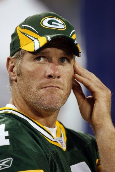 Brett Favre Photos Photos - (FILE PHOTO)  Brett Favre #4 of the Green Bay Packers watches the action from the bench during a preseason game on August 30, 2007 at LP Field in Nashville, Tennessee. According to reports, Favre will retire after 17 NFL seasons. - Green Bay Packers v Tennessee Titans