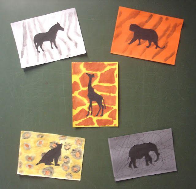 Achtergrond met motief dierenvacht in voorgrond komen de silhouetten