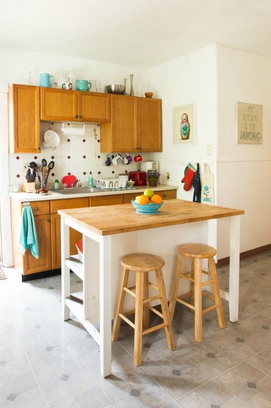 Such an adorable kitchen-love the pops of blues and greens and the DIY-style island