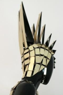 Paco Rabanne 1967. I think the fashion of the 60s (disc dress, links etc) is a good example of ideas that are inspiring me. I love the idea of tessellating pieces as they drape quite nicely around the body. Also the prisms/mohawk style is one way I am looking at portraying reptile spikes.