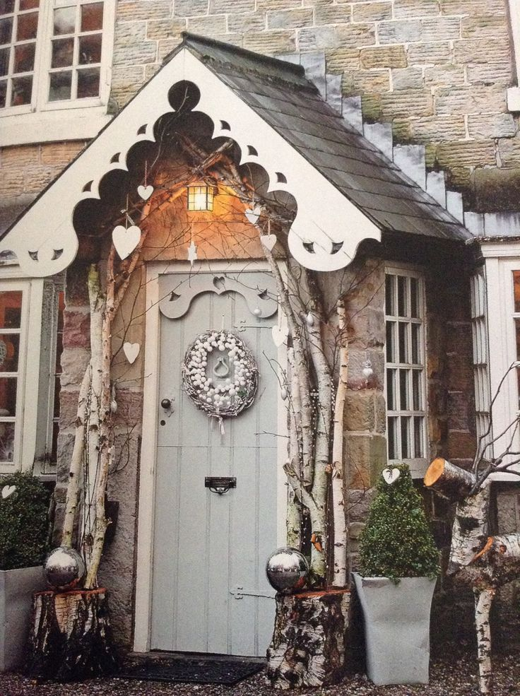 Beautiful porch and entrance decorated for Christmas with fairy lights and Christmas wreath                                                                                                                                                     More