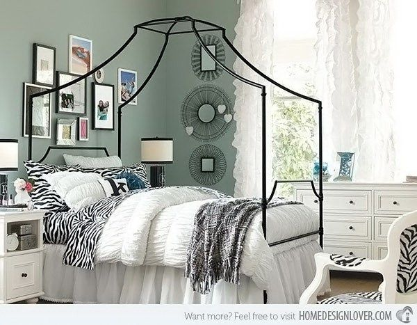 Maison Zebra Bedroom. A kind fashionable bedroom with animal printed accessories, wire graphic mirrors, gallery frames for a headboard  the canopy bed...Everything mixed all together well.