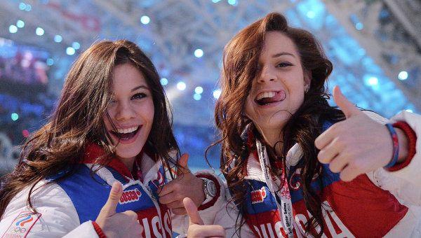 Russian figure skaters Elena Ilinykh and Adelina Sotnikova at the closing ceremony of the Sochi Olympics