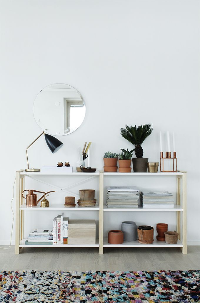 Apartment styled by Susanna Vento - Hege in France.  terracotta plant pots