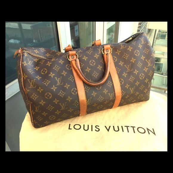 "Louis Vuitton vintage bag! This is a vintage, authentic Louis Vuitton duffle bag. Measures about 18"" x 10"" x 9""  Logos are facing the same way on all sides. Louis Vuitton Bags Travel Bags"