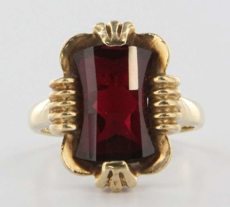 Overview: Offered for sale is a truly superb vintage ring, crafted beautifully in 10k yellow gold.  A fantasy cut synthetic ruby is set into the