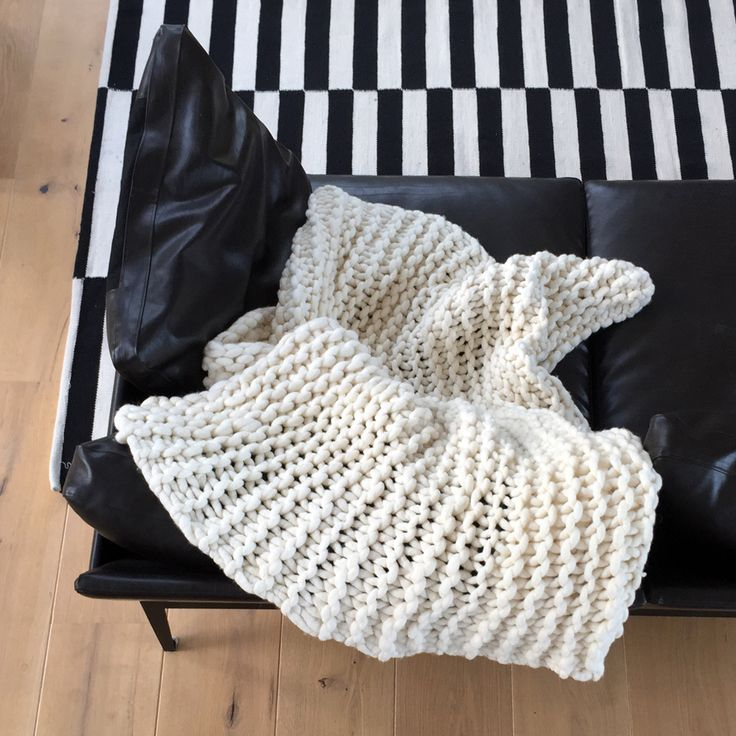 Made from beautiful natural creamy white merino wool, this chunky knit throw will make a statement in any room. All throws are lightly felted to minimise shedding.Measures approximately 100cm x 115cm. Ships in a cotton storage slip.