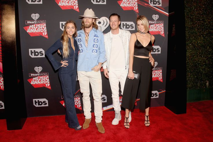 Musicians Brian Kelley (2nd L) and Tyler Hubbard (2nd R) of Florida Georgia Line with Brittney Marie Cole (L) and Hayley Stommel (R) attend the 2017 iHeartRadio Music Awards which broadcast live on Turner's TBS, TNT, and truTV at The Forum on March 5, 2017 in Inglewood, California. (Photo by Jesse Grant/Getty Images for iHeartMedia)