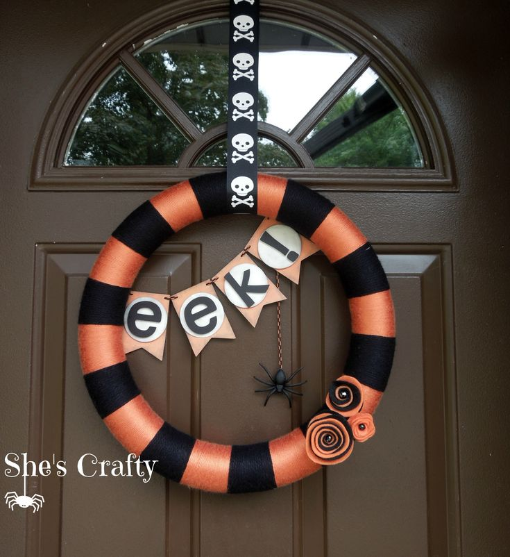 Halloween Wreath I made for my front door. Yarn, paper banner and spooky spider of course. #shescraftyintoledo
