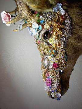 really cool taxidermy piece with vintage accessories