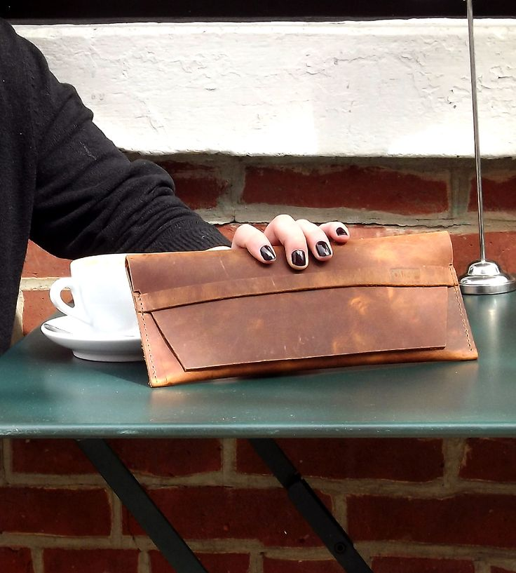 Meant to be around much longer than the next fad, this leather clutch is built to last.