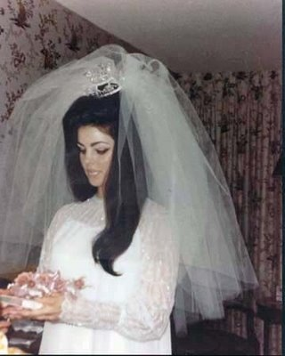 Priscilla Presley, 1967 I like this picture because it looks like the type a grandmother would have on her mantelpiece. It looks like a picture you'd find in anybodys photo album under the stairs. She dosent look like a celebrity atall,she looks like a normal,beautiful young lady.