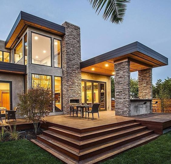 Fantastic combination of stone, wood and concrete. Masterful use of vertical and horizontal lines. Definitely in my top 25