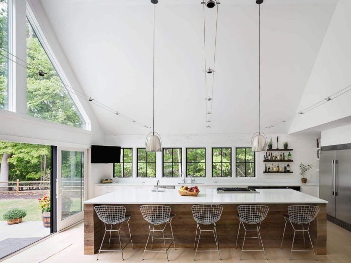 How will change some huge windows and forrest surroundings an almost typical US house into an inspiring home - CAANdesign | Architecture and home design blog
