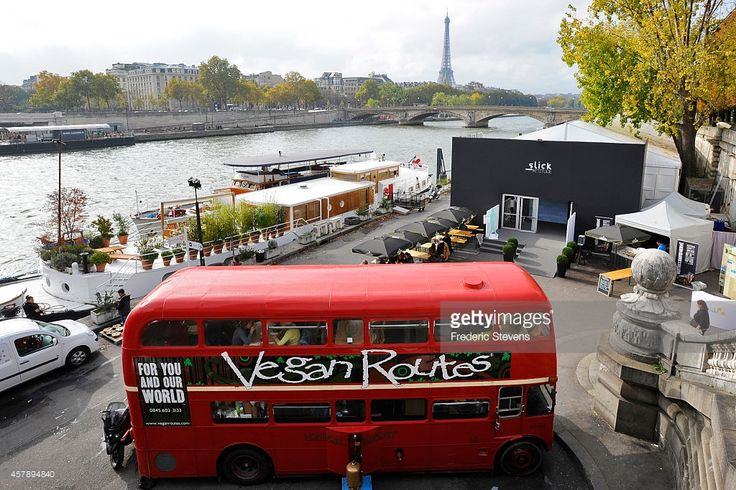 A general view of the The 'Vegan Routes' bus restaurant during The Slick Art Fair and the FIAC, at Pont Alexandre III on October 26, 2014 in Paris, France . The restaurant, converted from an original British double decker routemaster bus has travelled from Soho in London to serve organic vegan food in the French capital.