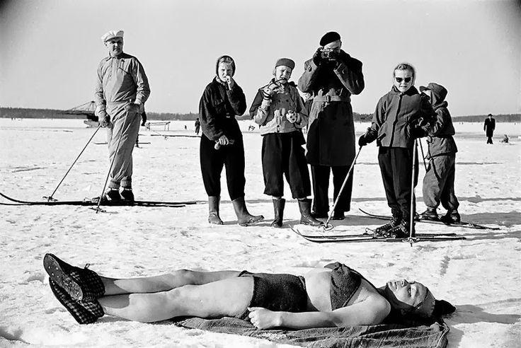 Sunbathing on the ice after swimmingHelsinki 1952 from the exhibit Hulluna Helsinkiin /Helsingin Kaupunginmuseo